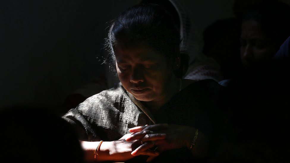 An Indian Christian woman prays at a cathedral in New Dehli