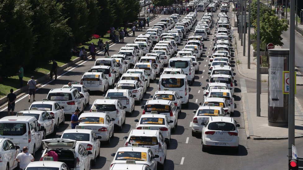 Taxi drivers with their vehicles block the Paseo de la Castellana avenue in downtown during another day of taxi strikes, in Madrid, Spain, 30 July 2018