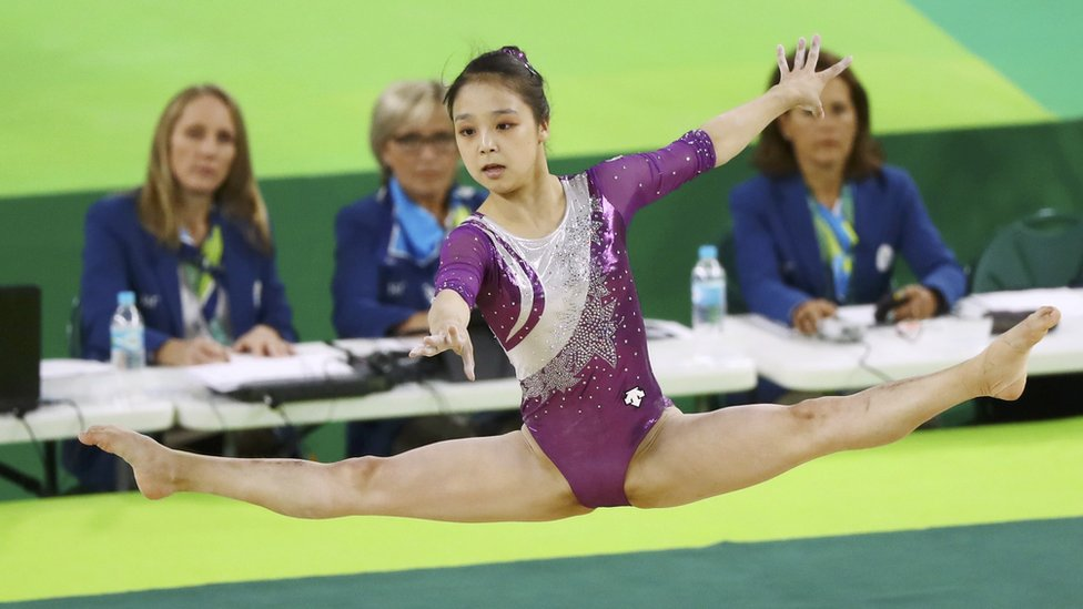 """Lee Eun Ju (KOR) of South Korea competes on the floor during the women""""s qualifications."""