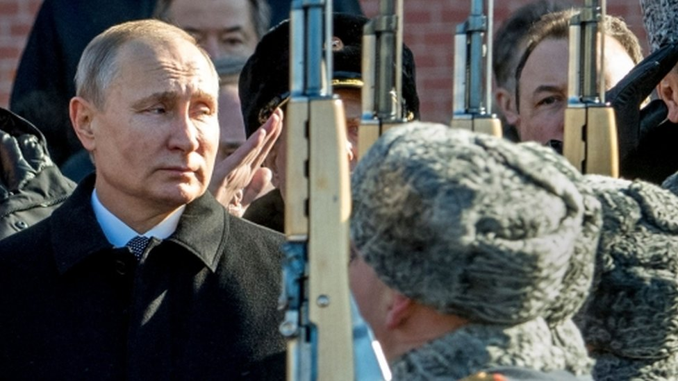 Vladimir Putin watching military parade
