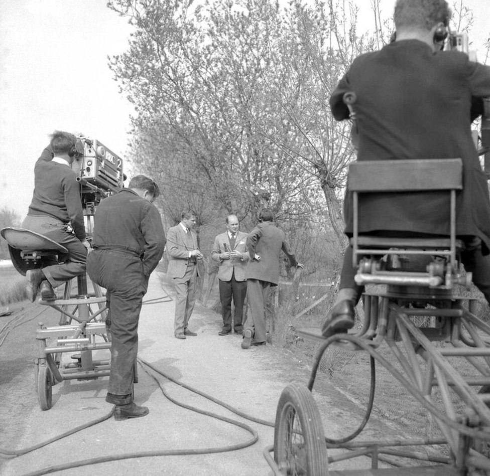 David Attenborough and Peter Scott talking, during a break in filming at Slimbridge, with stage manager Ray Kite.