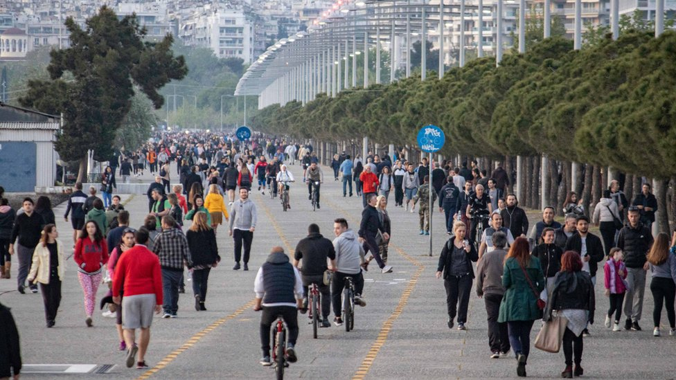 Crowd of thousands of people are seeing walking and running at the popular for locals and tourists New Promenade of Thessaloniki on 27 April