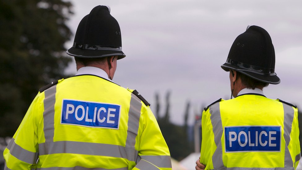 Two police officers are pictured