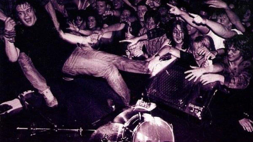 Carl Bevan goes crowd surfing