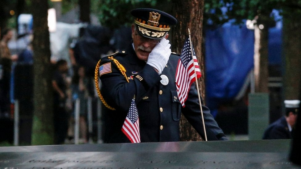 A guest wipes a tear at the New York memorial