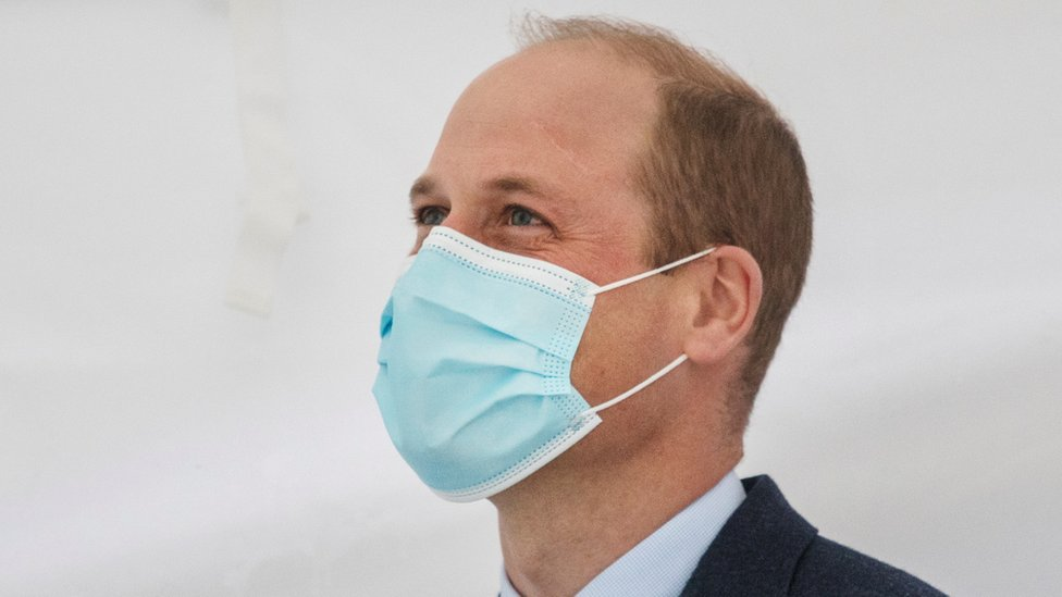 Prince William wearing a mask