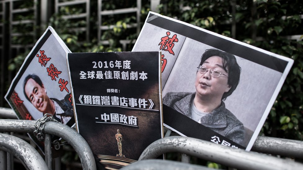 Placards showing missing bookseller Lee Bo and his associate Gui Minhai