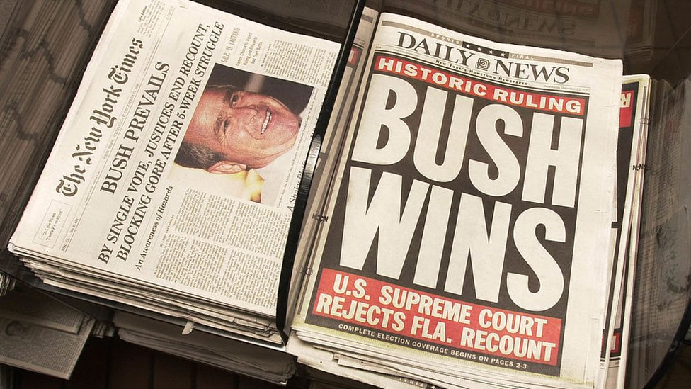 Newspapers give the results of the US Supreme Court''s decision to halt the Florida ballot recount, claiming George W Bush as the victor for the presidency December 13, 2000