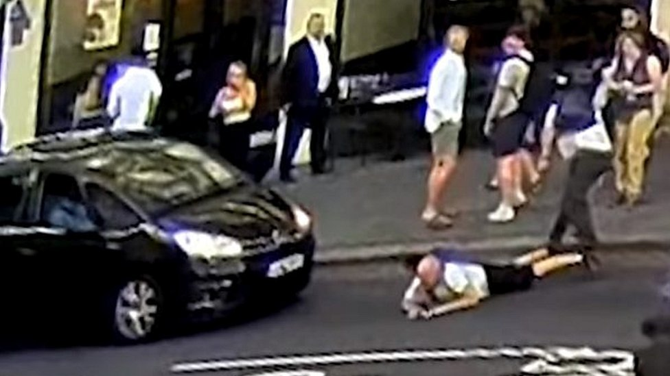 Man pushed into London traffic after 'exchange of words'