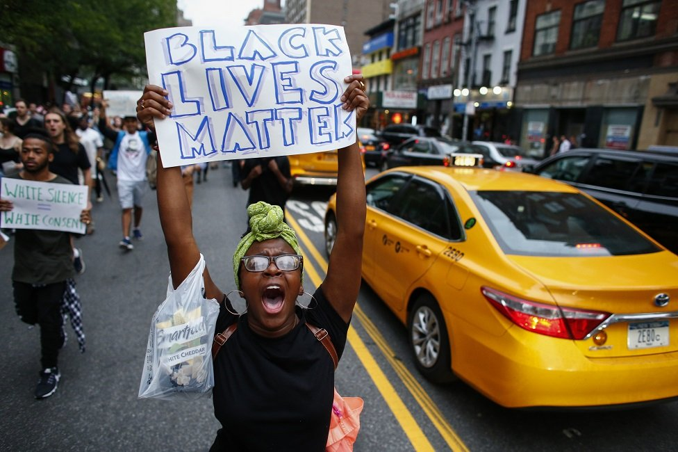 People take part in a protest on 8 July 2016 in New York City