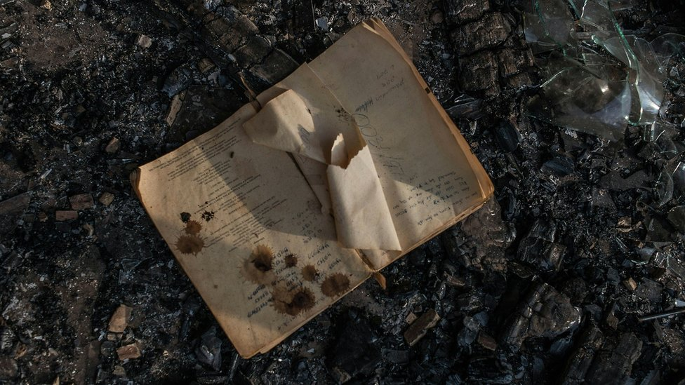 A book in the ashes of a classroom of a school torched in Limpopo, South Africa - May 2016