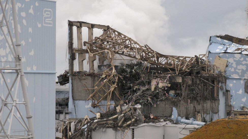 15 March 2011 photo taken and provided by Tokyo Electric Power Co. (TEPCO), showing the destroyed remains of the Unit 3 reactor building in the Fukushima Dai-ichi nuclear power plant in Okuma, Japan.