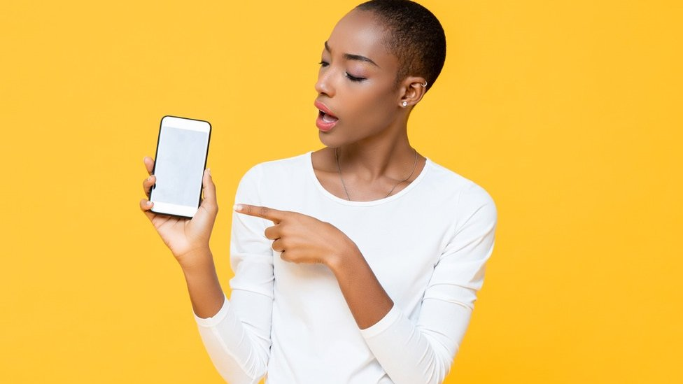 Black woman with a phone