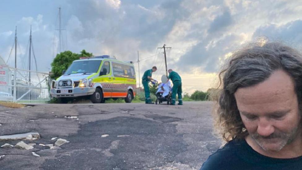 Paramedics treat a fugitive who was found by two fishermen near Darwin