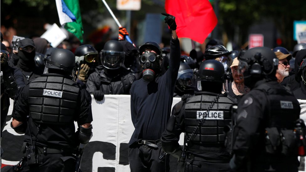 Counter-demonstrators are held back by police during a rally in Portland, 4 August 2018