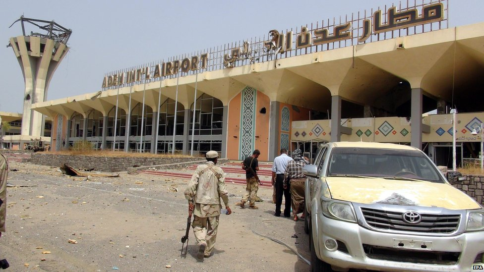 Yemeni pro-government fighters outside Aden's international airport on 14 July 2015