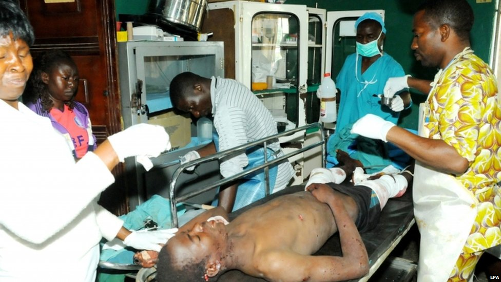 Hospital staff attend to injured people after two bomb blasts at the city centre in Jos, Nigeria (06 July 2015)