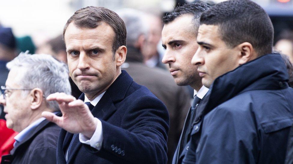 Emmanuel Macron (L)