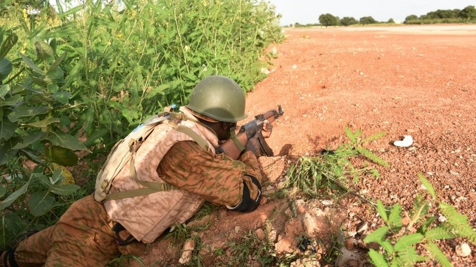 A Burkinabe soldier stands in position near the presidential guard's barracks on 29 September 2015 in Ouagadougou