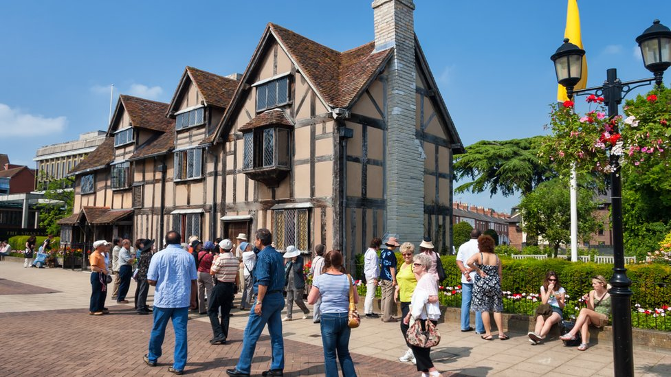 A tourist group waiting in front of Shakespeare's Birthplace at Henley Street. Shakespeare's Birthplace