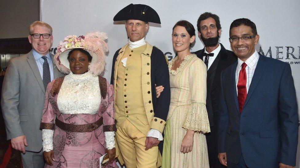 D'Souza (far right) attends a 2014 film screening