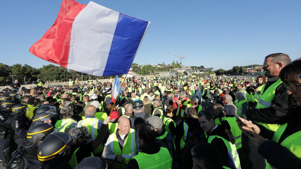 police attend as protesters block a motorway in Antibes, southern France