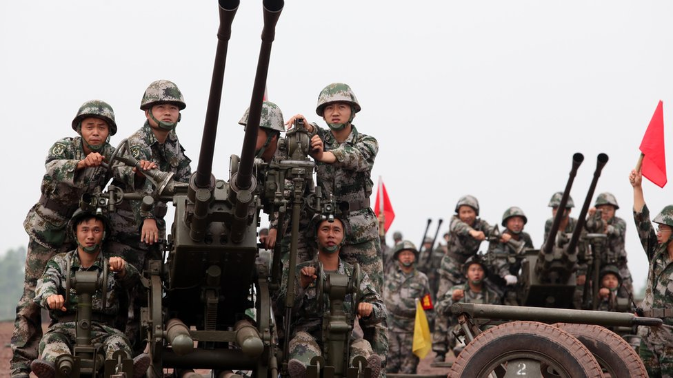 Chinese troops practice with anti-aircraft guns during drills