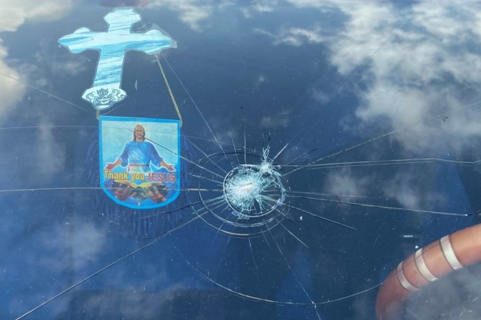A view shows the damaged window of a car decorated with a cross in Lagos, Nigeria October 22, 2020.