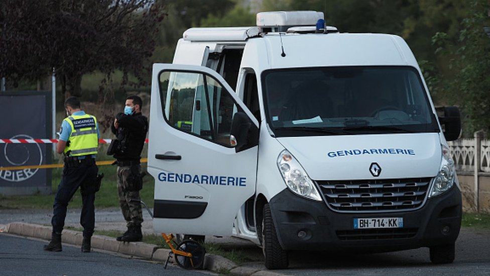 French gendarmes work next to the site where an ULM crashed in Loches