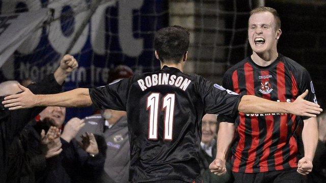 Jordan Owens celebrates with team-mate Josh Robinson at Seaview