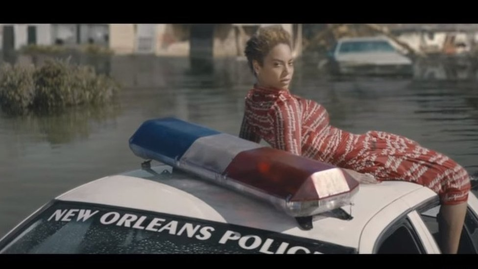 Beyonce on a submerged police car