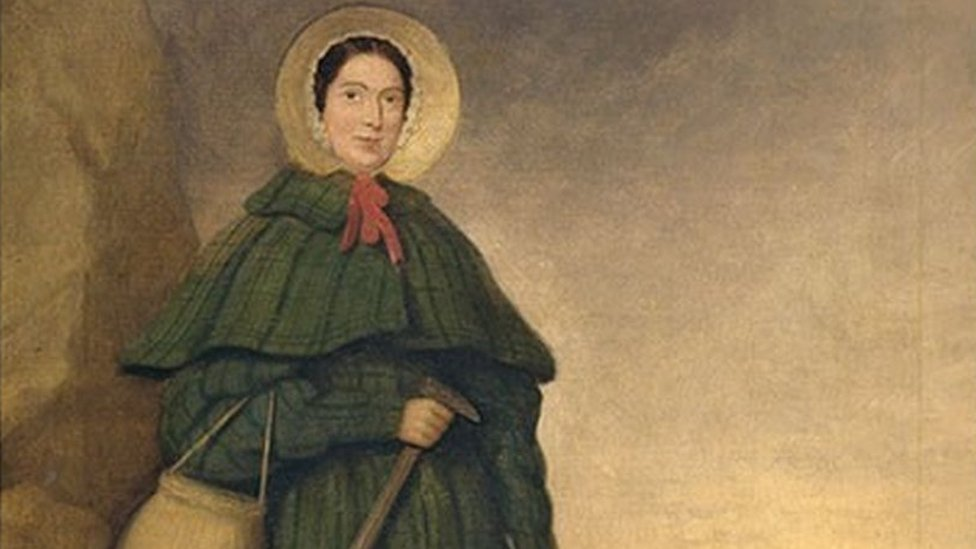 Painting of Mary Anning wearing a bonnet and a large green coat