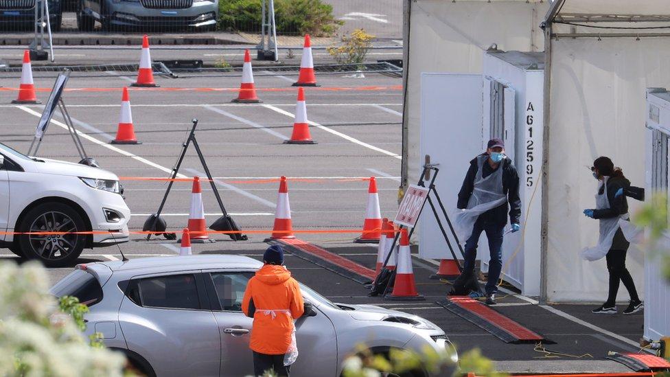 Cars at a drive-through testing centre