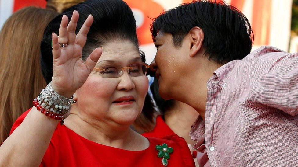 Philippines Vice-Presidential candidate BongBong Marcos whispers to his mother, former First Lady and Congresswoman Imelda Marcos