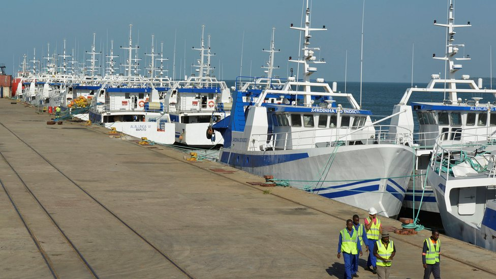 Security guards patrol past the EMATUM fishing fleet docked in Maputo, Mozambique, May 3, 2016.