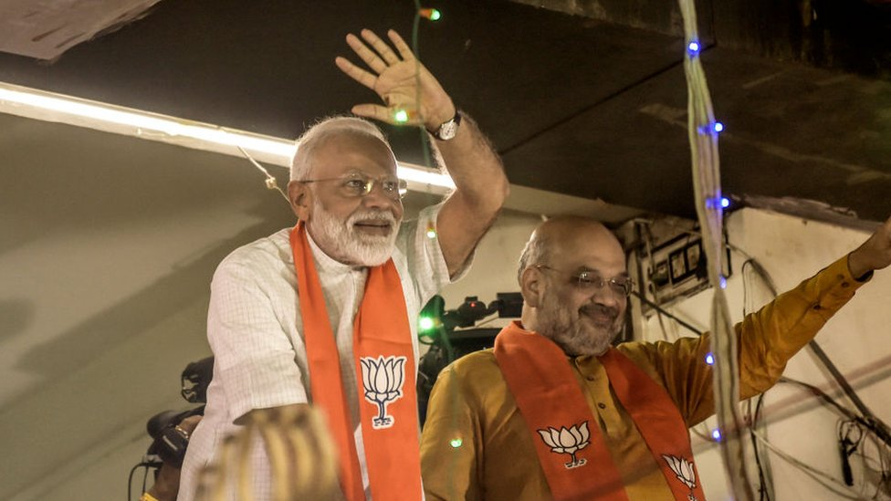 Narendra Modi waves to the supporters from the first BJP Party Office May 26, 2019 in Ahmedabad, India