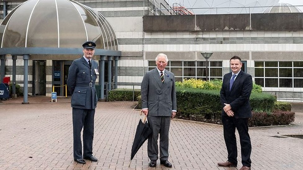 Prince Charles alongside Sqn Ldr Geoff Dickson (left) and director general of technology at GCHQ Gav Smith