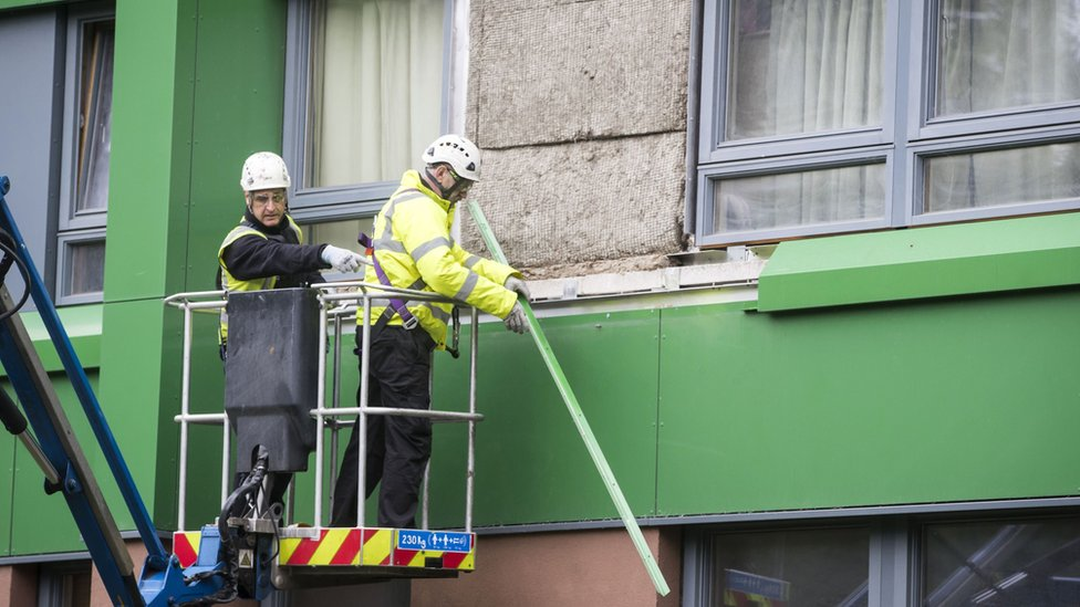 Cladding being removed from a tower block in Sheffield