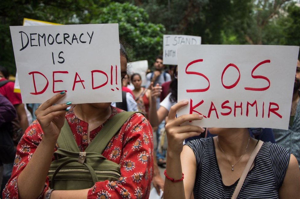 People attend a protest in solidarity with Kashmir over the removal of Article 370 in Delhi on 7 August.
