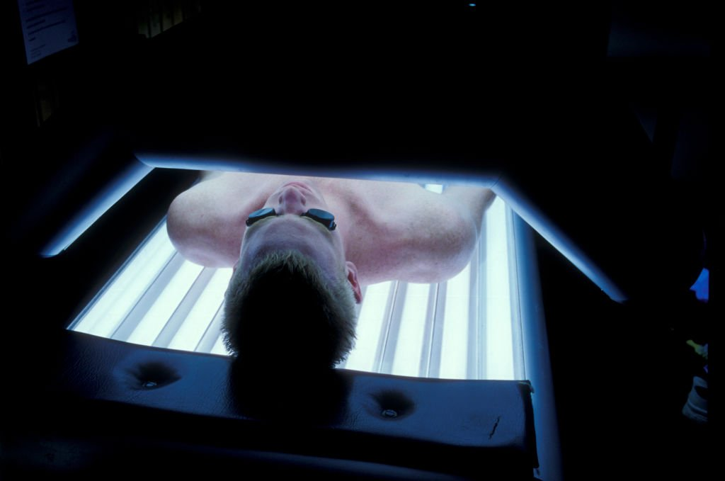 Man laying on a sunbed