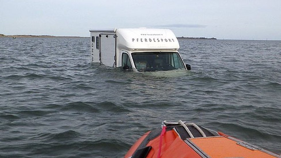 Driver stranded at high tide on Holy Island causeway