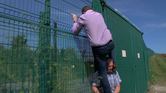 MEP Mike Hookem climbs the fence to prove how easy it is to scale