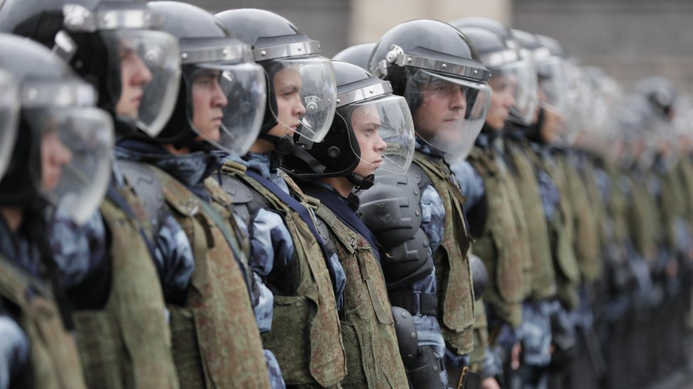 Russian riot police stand in readiness during a liberal opposition rally against unfair Moscow State Duma elections in the centre of Moscow, Russia, 10 August 2019.