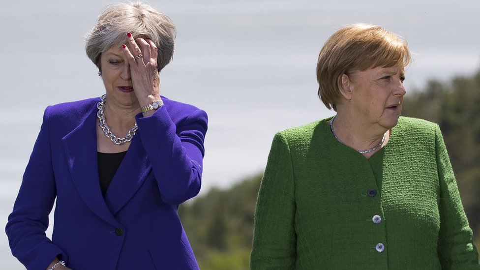 Theresa May and German Chancellor Angela Merkel at the G7 summit in Canada