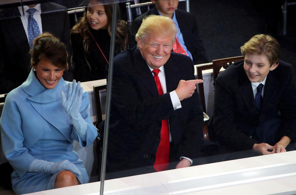President Donald Trump, First Lady Melania Trump and Barron Trump watch the inaugural parade