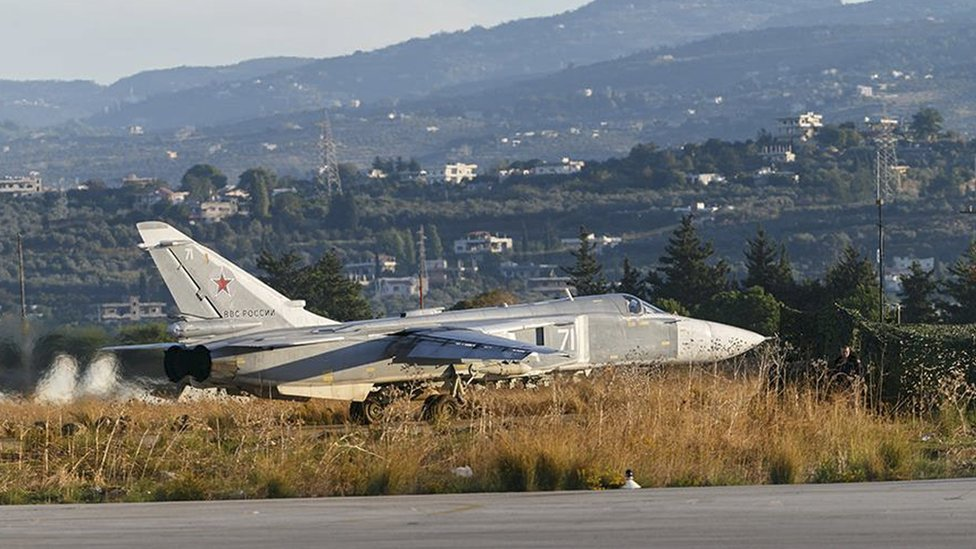 A Sukhoi Su-24 fighter jet taxis on the tarmac at the Humaymim air base near Latakia, Syria (11 November 2015)
