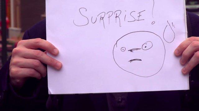 Sign saying 'surprise'