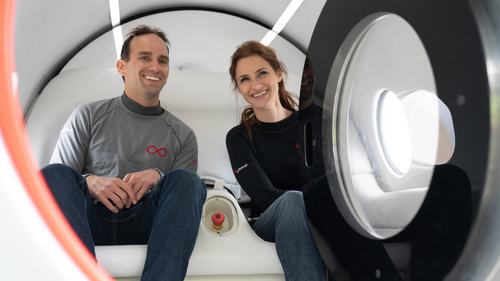 Sara Luchian and Josh Giegel inside their pod