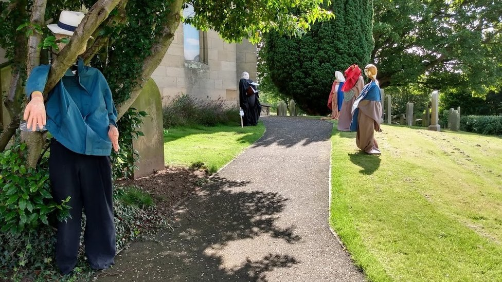 Scarecrows in churchyard