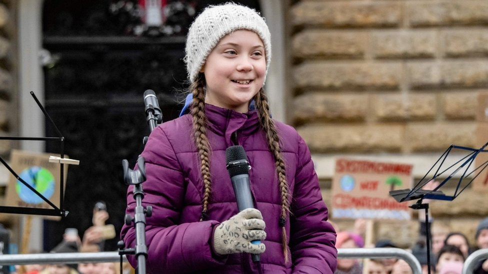 Swedish climate activist Greta Thunberg speaks on stage during a demonstration of students calling for climate protection on 1 March 2019 in front of the city hall in Hamburg, Germany